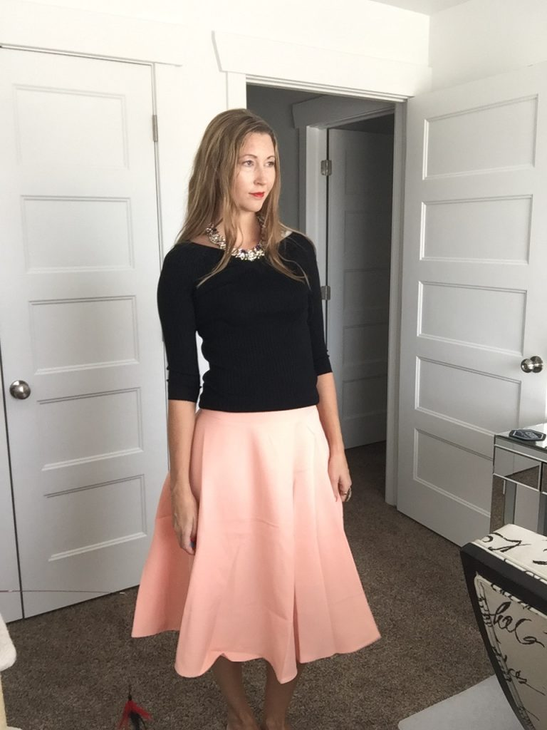 black 3/4 sleeve sweater and peach skirt