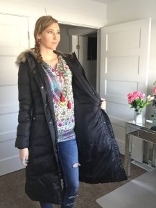 Long Black hooded coat, distressed jeans, and retro hippie shirt