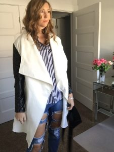 White coat with Black Sleeves, Striped shirt, and Distressed Denim