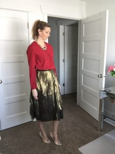 red blouse and gold metallic skirt