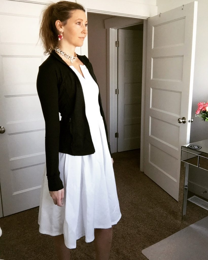 black fitness jacket and white a line dress