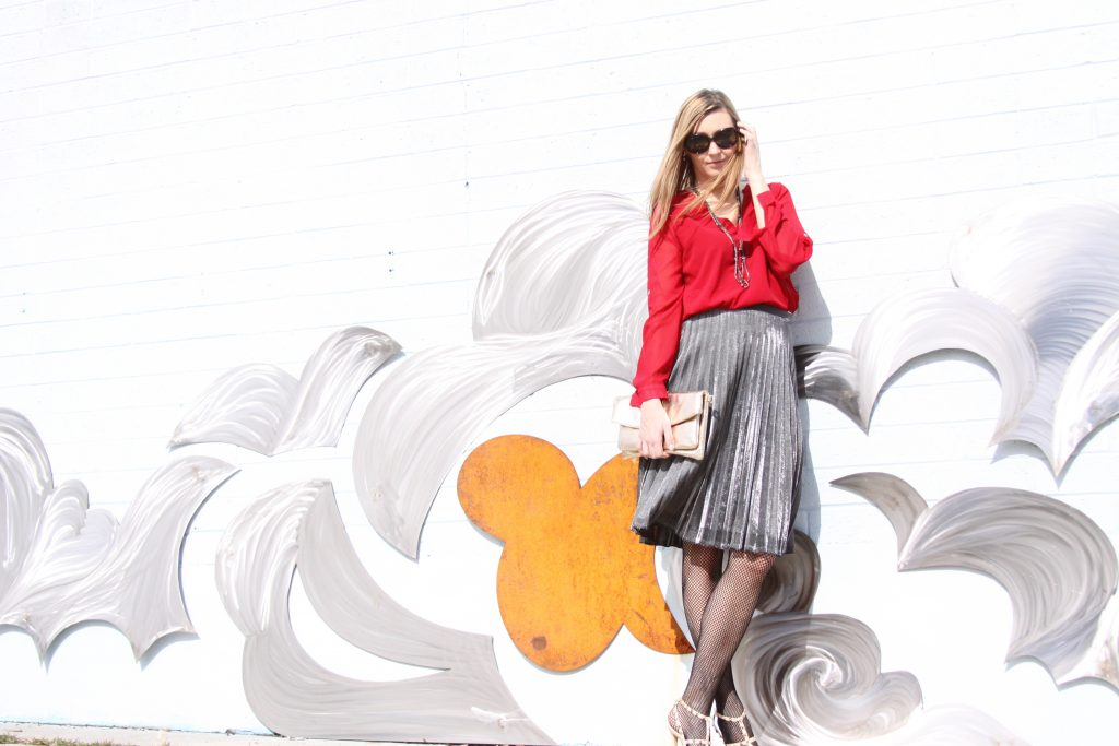 red blouse and silver pleated skirt