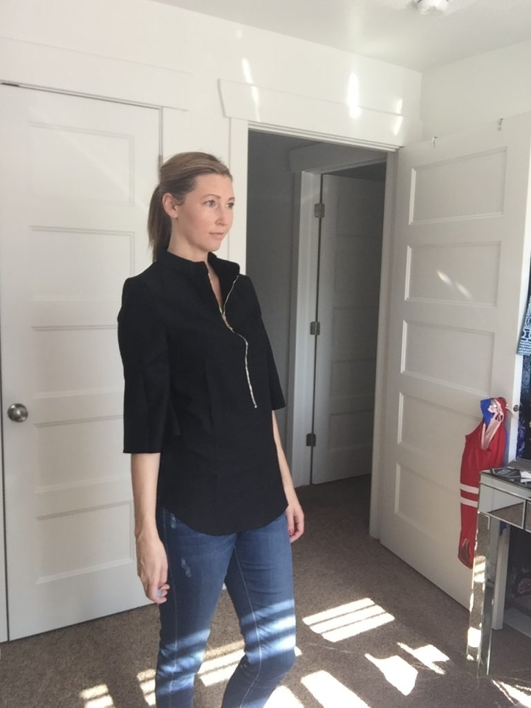 Woman in Black 3/4 Sleeve Zip Front Blouse and jeans