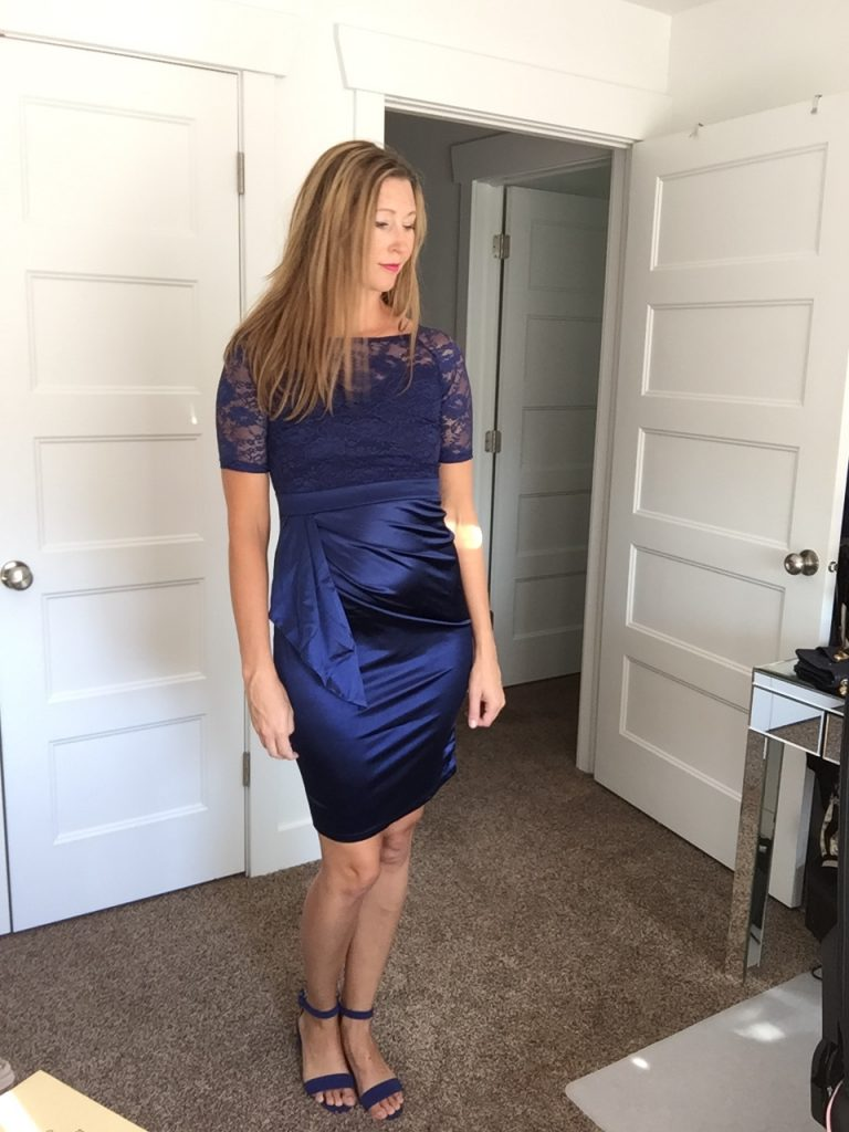 woman in Chic Blue Satin Lace Dress