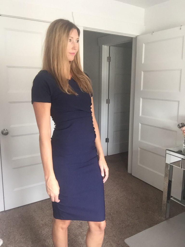 woman in Chic Dark Blue Sheath Dress