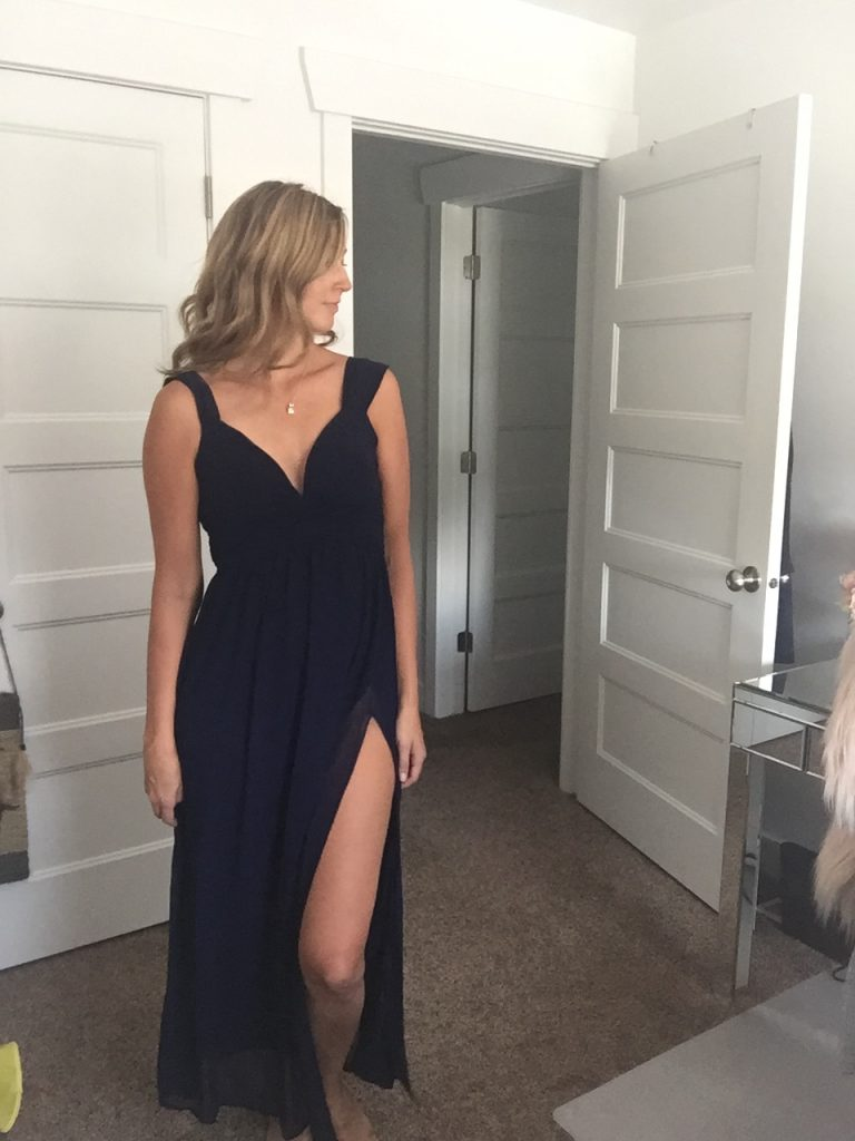 Woman in Gorgeous Black Hight Slit Gown